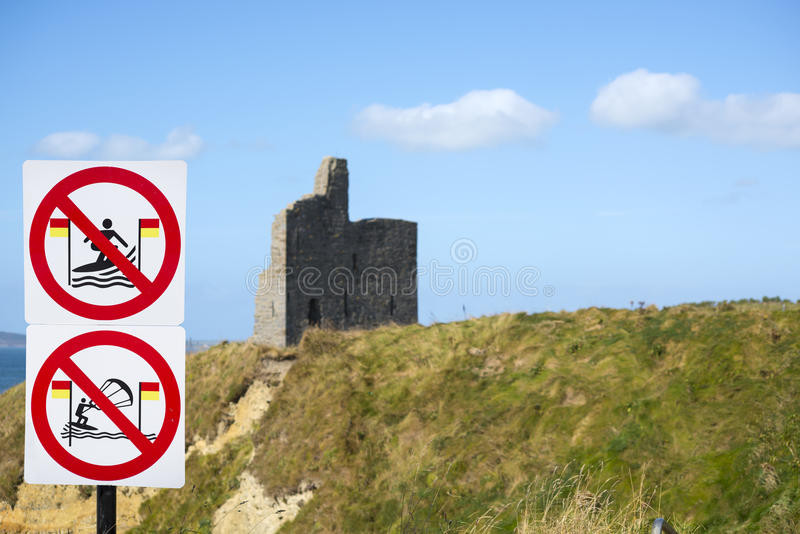 Warning signs for surfers at castle. Warning signs for surfers at ballybunion castle on the wild atlantic way in ireland royalty free stock photography