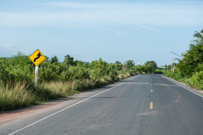 Warning signs tell road conditions. In rural area royalty free stock photography