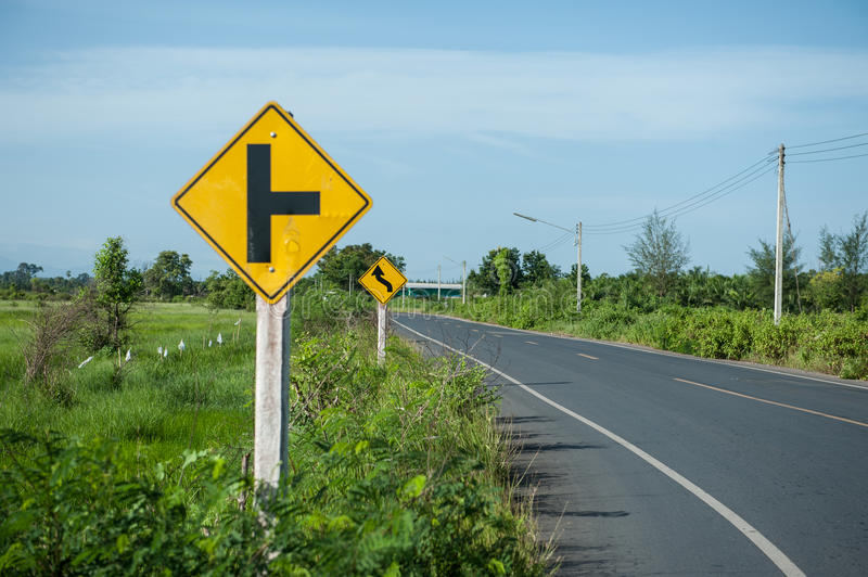Warning signs tell road conditions. In rural area royalty free stock images