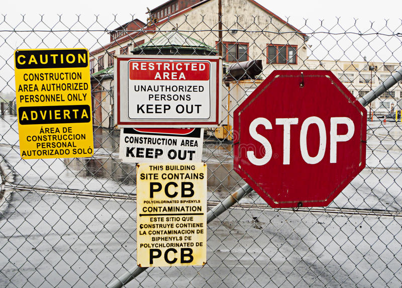 Warning signs to keep out of dangerous area stock photo