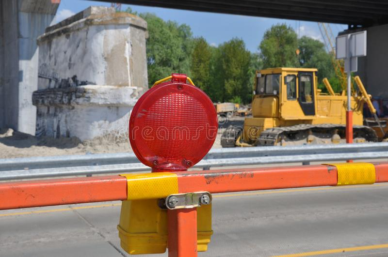 Warning signs for work in progress on road under construction. Bridge repair. Warning signs for work in progress on road under construction royalty free stock images