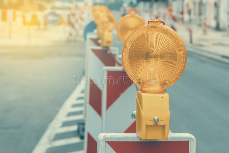Warning signs for work in progress. On road under construction. Vintage and retro style and shallow dof royalty free stock photo