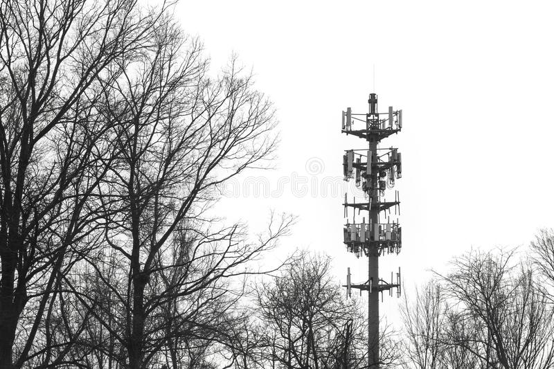 Warning siren radio communications tower high contrast telecommunication equipment. High contrast warning siren tower to alert public to storms or other stock photo