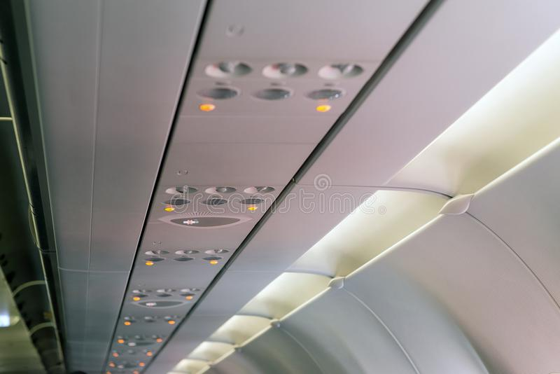 Warning of smoking ban or non smoking sign on airplane,light symbol on aircraft,seat belt stock photos