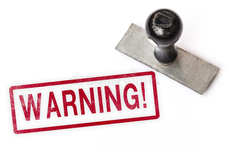 Warning text label stamp royalty free stock photography