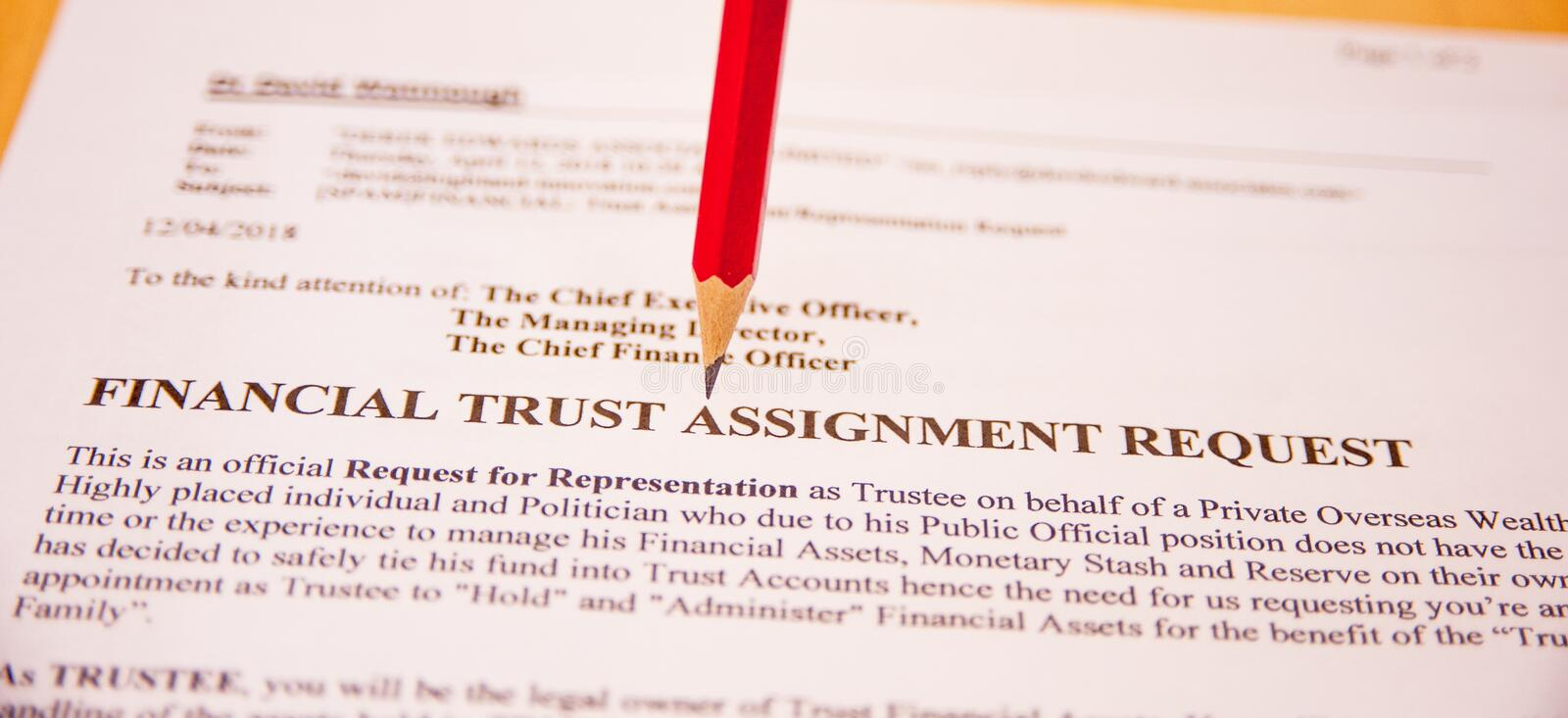 Warning; too good to be true. Text `financial trust assignment request` with red pencil to underline danger. Its an invitation to look after someone else`s money stock photo