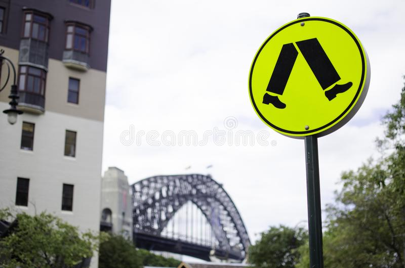 Warning traffic signs for pedestrian crossing in yellow circle. stock image