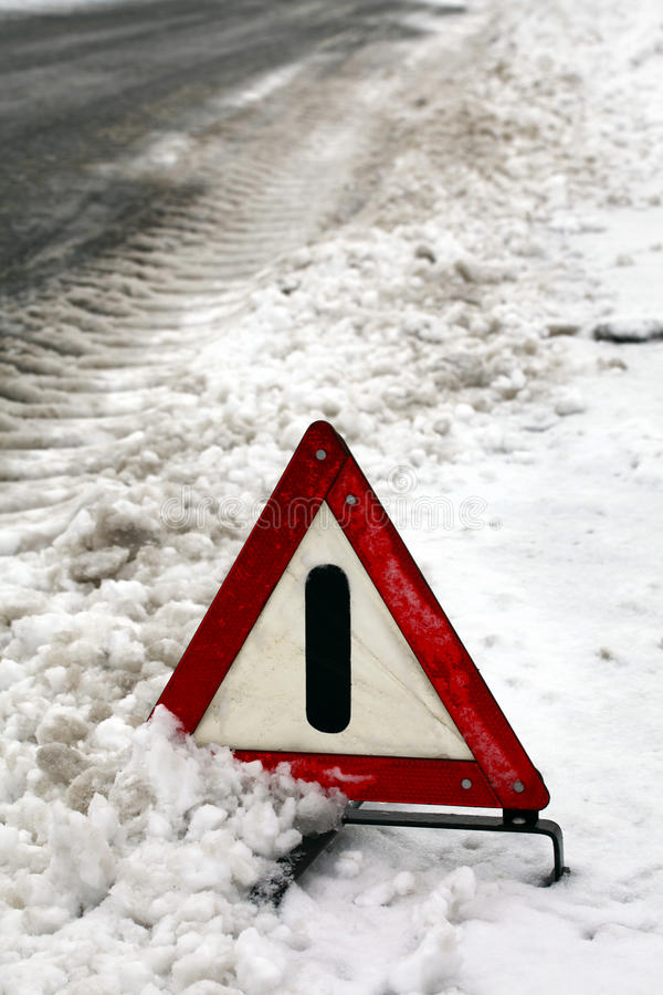 Warning triangle at snowy road. Accident. Warning triangle on winter road stock photo