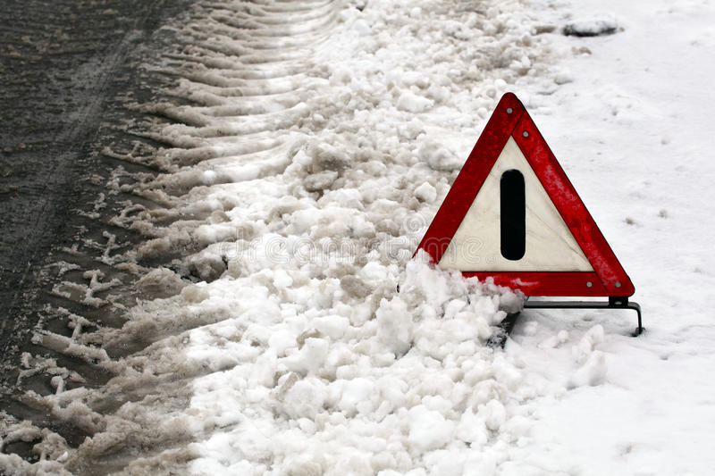 Warning triangle on winter road. Accident. Warning triangle on winter road royalty free stock photos