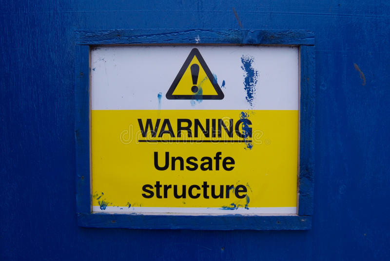 Warning!! Unsafe. Warning sign, unsafe structure ahead stock photos