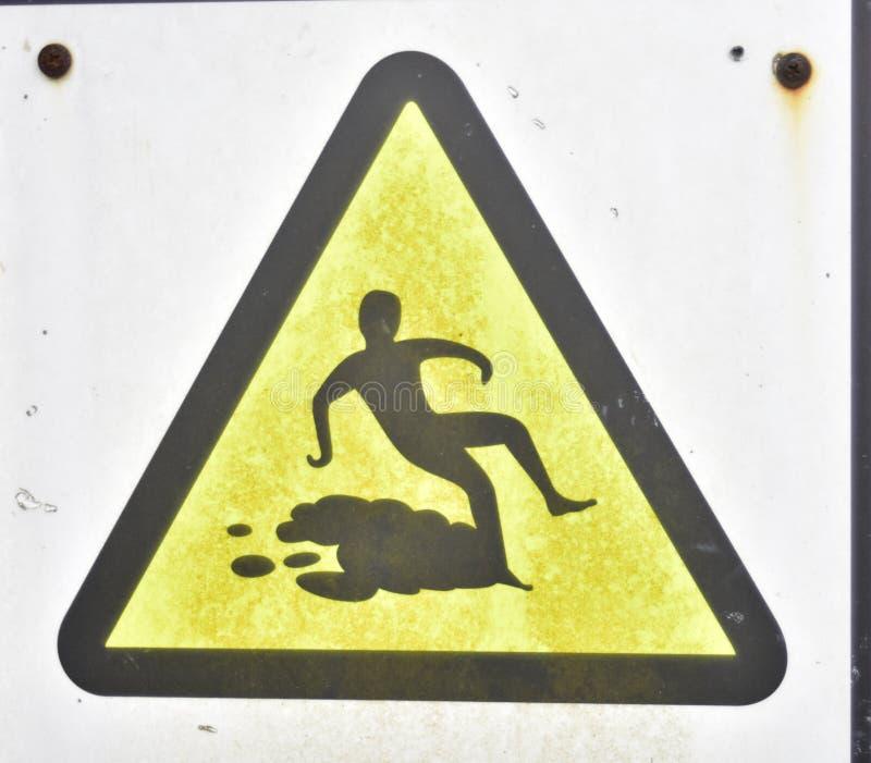 Warning yellow sign Hazard symbol, careful to slip royalty free stock photo