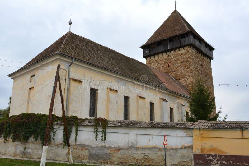 Warownego średniowiecznego saxon ewangelicki kościół w wiosce Barcut, Bekokten, Brekolten, Transylvania, Rumunia zdjęcie stock