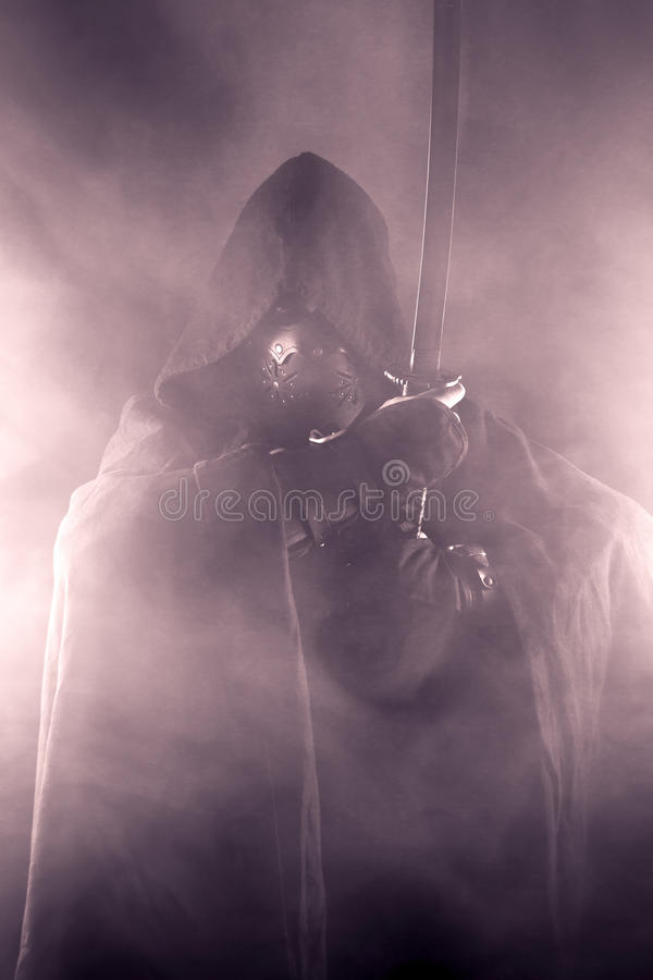 Warrior in abstract smoke. Warrior with sword in abstract smoke on the black background royalty free stock images