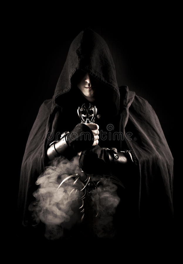 Warrior in abstract smoke. Warrior with sword in abstract smoke on the black background stock photos