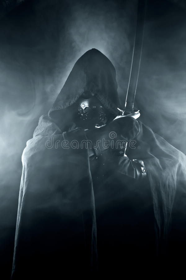 Warrior in abstract smoke. Warrior with sword in abstract smoke on the black background stock image