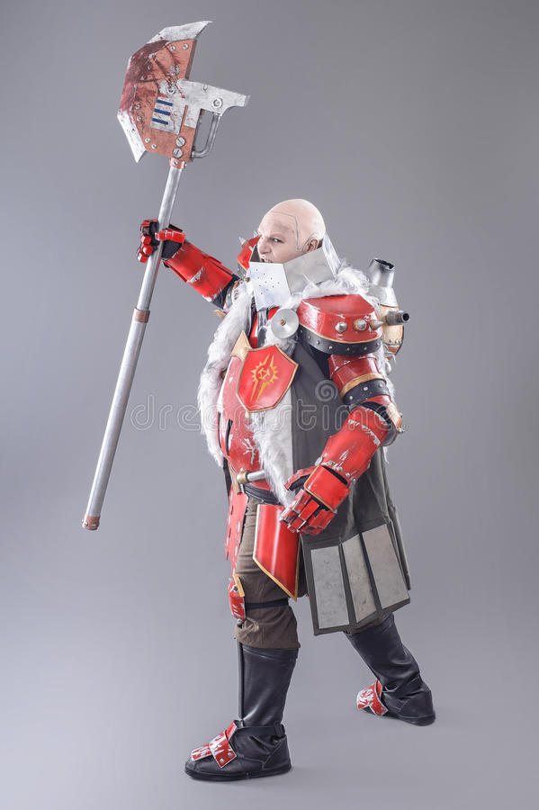 Warrior in the Armor with Axe. Fantasy Medieval Warrior in the Armor with big Axe. Isolated Background stock photography