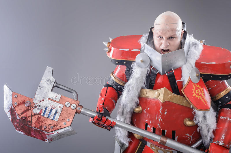 Warrior in the Armor with Axe. Fantasy Medieval Warrior in the Armor with big Axe. Isolated Background royalty free stock photography