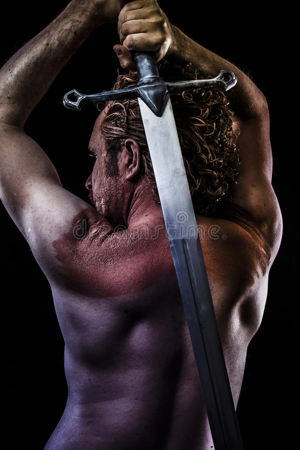 Warrior with big sword, muscular back royalty free stock photography
