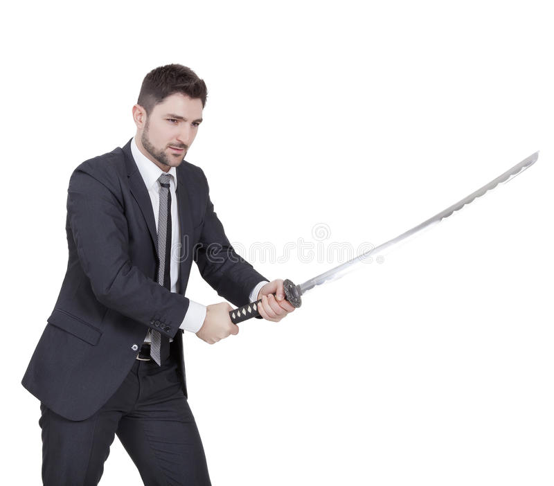 Warrior businessman. With black suit and a katana in his hands stock images