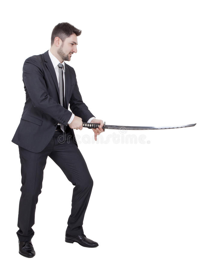 Warrior businessman. With black suit and a katana in his hands royalty free stock image