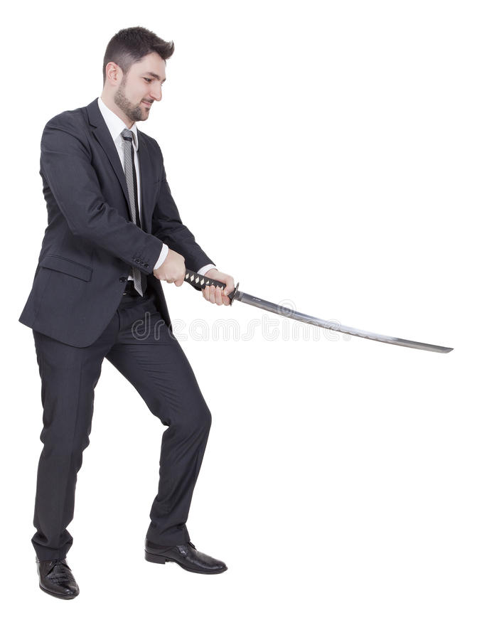 Warrior businessman. With black suit and a katana in his hands royalty free stock photos