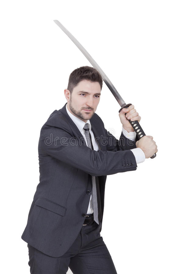 Warrior businessman. With black suit and a katana in his hands royalty free stock photography