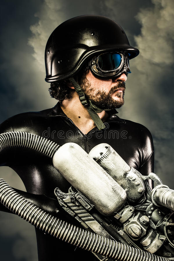 Warrior of the future with huge laser cannon shotgun over clouds stock photo