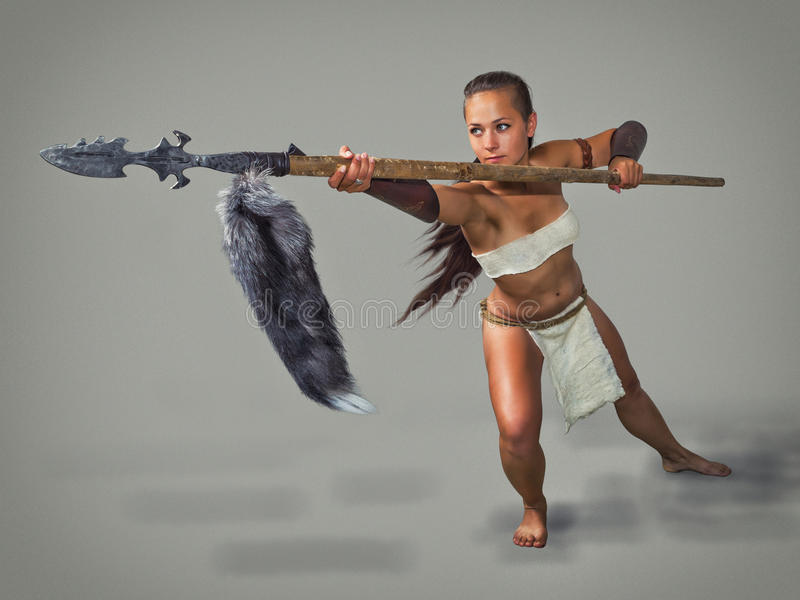Warrior girl ancient. Poke with a spear. stock photography