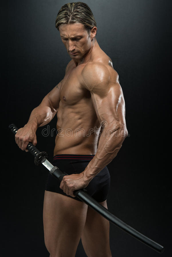 Warrior With Long Sword Over Black Background stock image