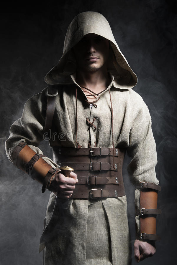 man in a cape with a knife in his hand stock photos