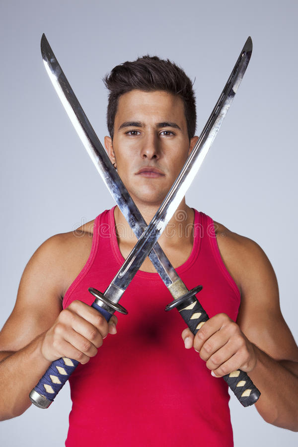 Warrior with ninja swords stock photography