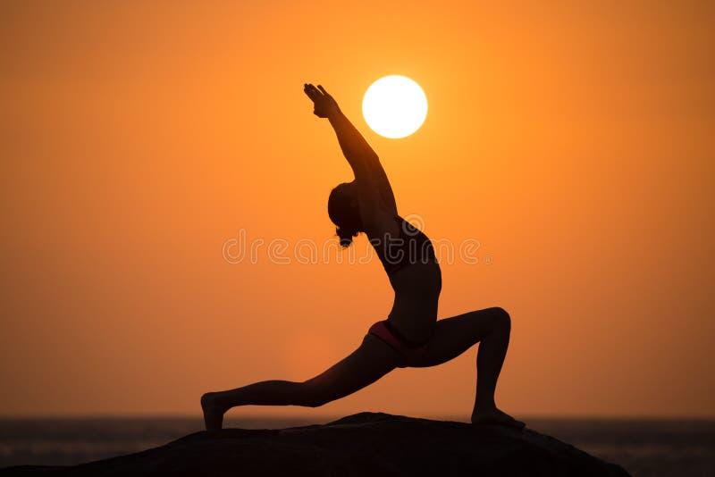 Warrior pose on sunset royalty free stock photos