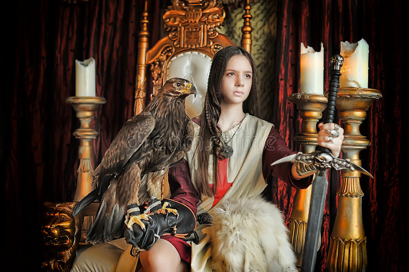 Warrior Princess on the throne. With an eagle sitting stock image