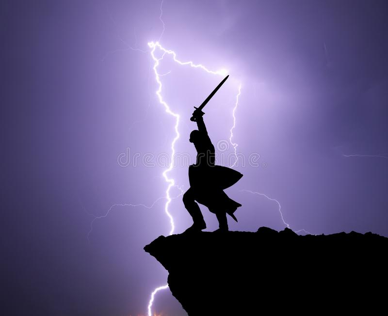 Warrior silhoutte and lightning. royalty free stock photos