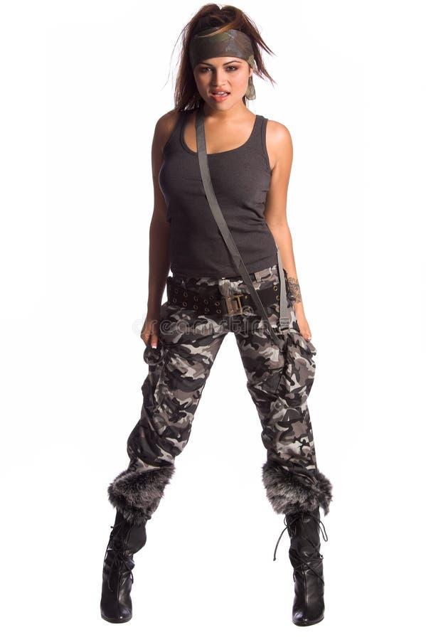 Warrior Woman. Beautiful young Latina Warrior Woman in military camo royalty free stock photos