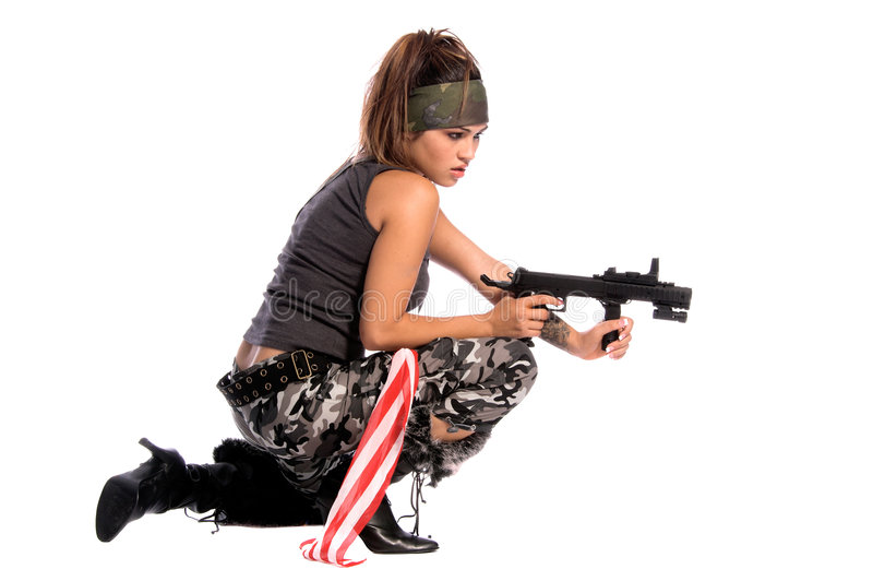 Warrior Woman. Beautiful young Latina Warrior Woman in military camo with an automatic assault weapon royalty free stock photos