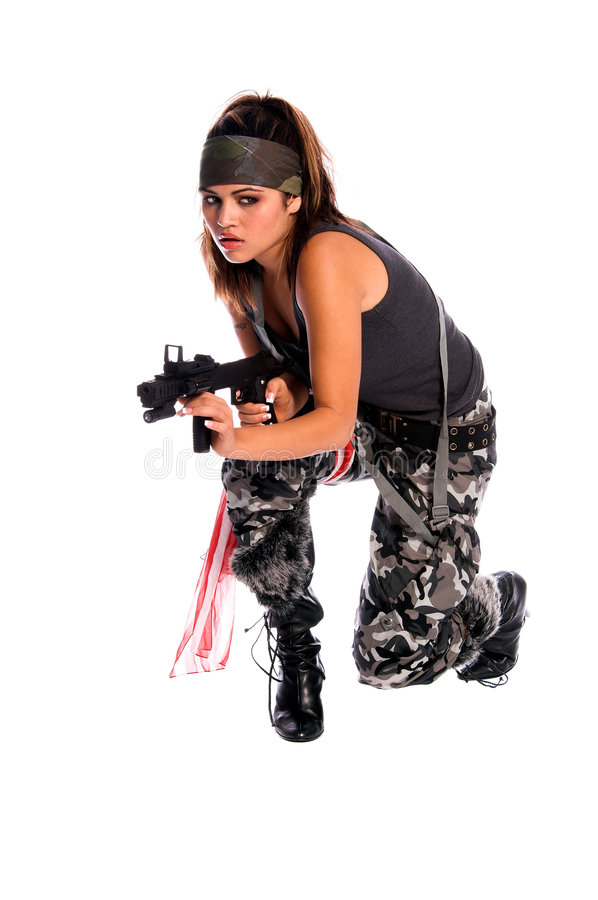Warrior Woman. Beautiful young Latina Warrior Woman in military camo with an automatic assault weapon royalty free stock photography