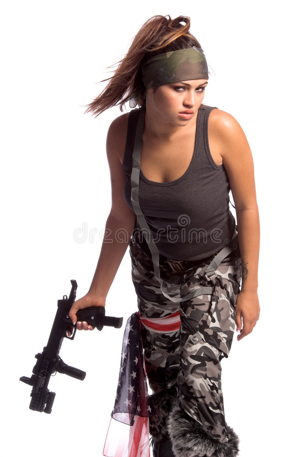 Warrior Woman. Beautiful young Latina Warrior Woman in military camo with an automatic assault weapon royalty free stock photo