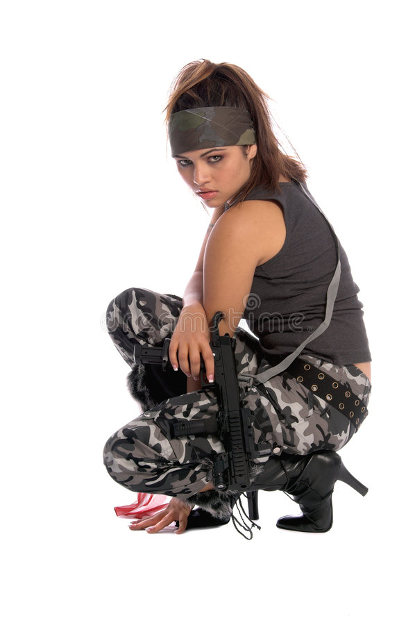 Warrior Woman. Beautiful young Latina Warrior Woman in military camo with an automatic assault weapon royalty free stock images