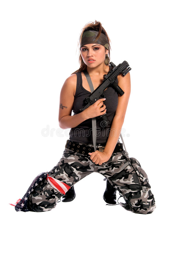 Warrior Woman. Beautiful young Latina Warrior Woman in military camo with an automatic assault weapon stock image