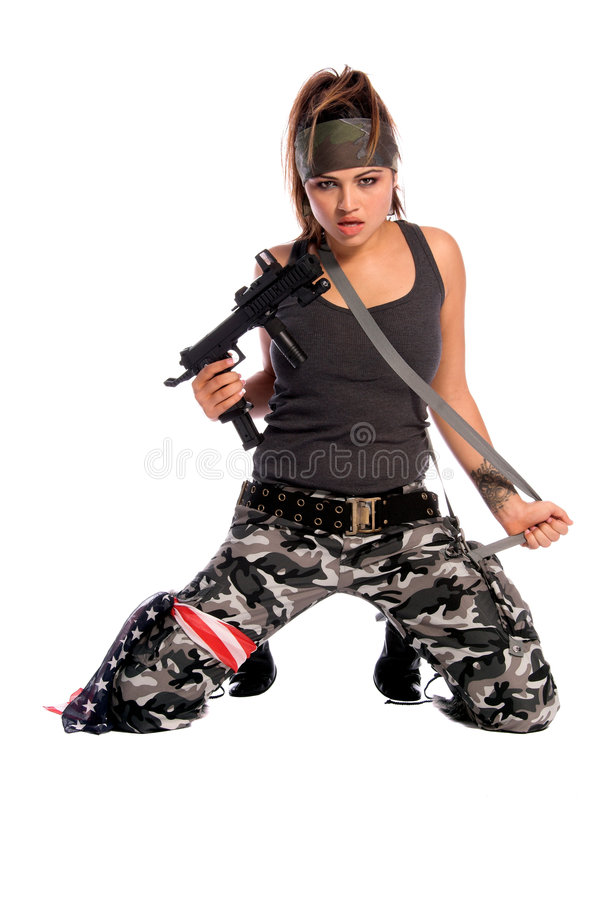 Warrior Woman. Beautiful young Latina Warrior Woman in military camo with an automatic assault weapon royalty free stock image