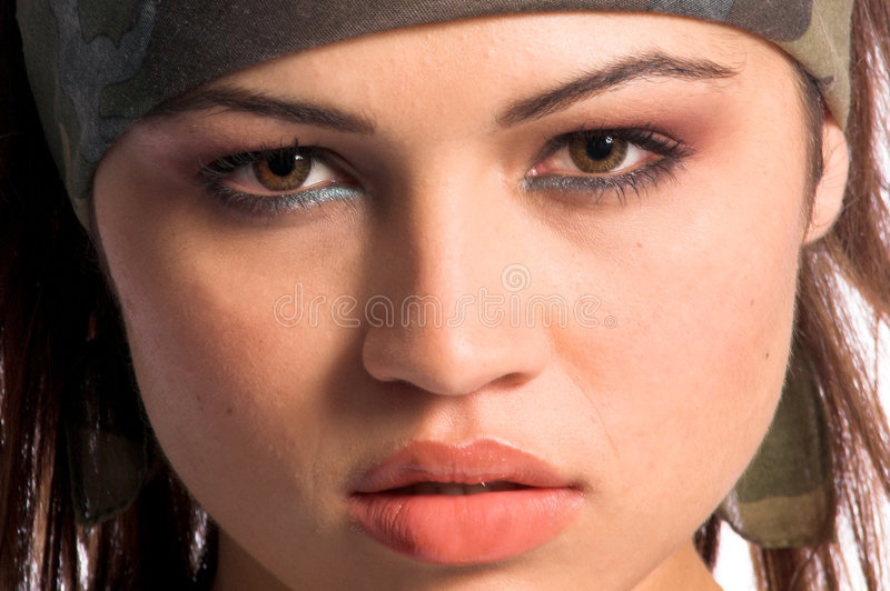 Warrior Woman. Beautiful young Latina Warrior Woman in military camo royalty free stock images