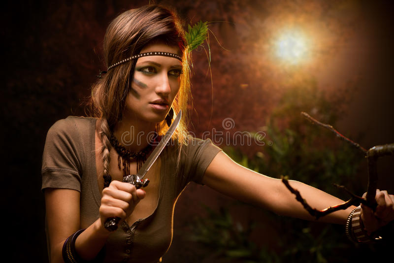 Warrior Woman With Combat Knife. Portrait of a warrior woman with combat knife at sunset stock images