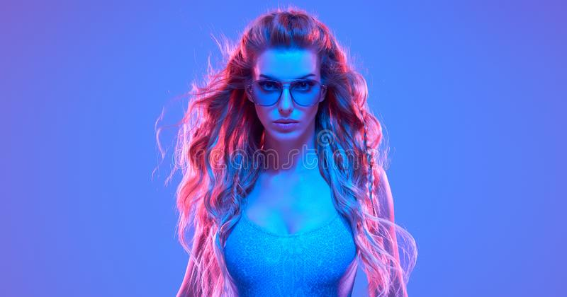 Warrior woman in Fashion neon light. Creative Art. Warrior woman in Pink Blue neon light, Trendy Hairstyle. High Fashion. Creative Colorful Bright Portrait royalty free stock photography