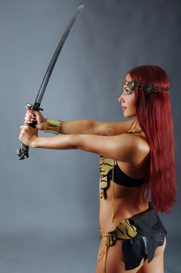 Warrior woman holding sword in her hand royalty free stock photos