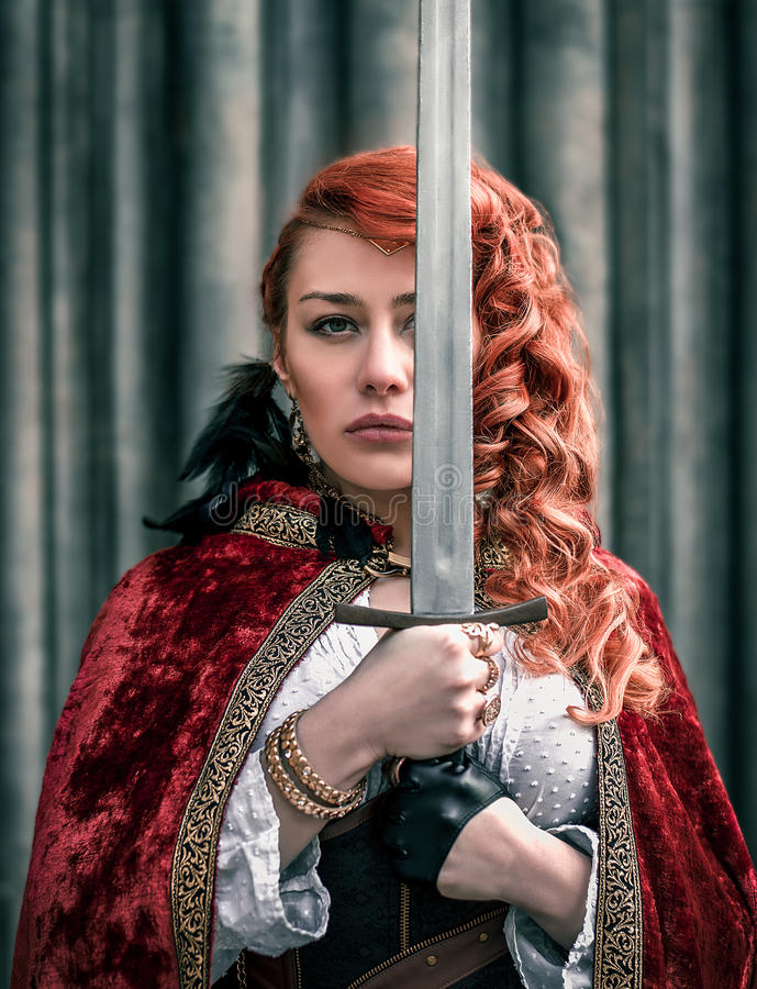 Warrior woman with sword in medieval clothes portrait stock image