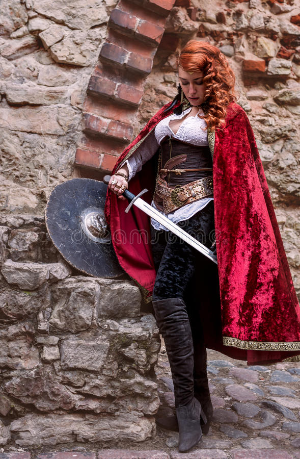 Warrior woman with sword in medieval clothes is very dangerous royalty free stock images