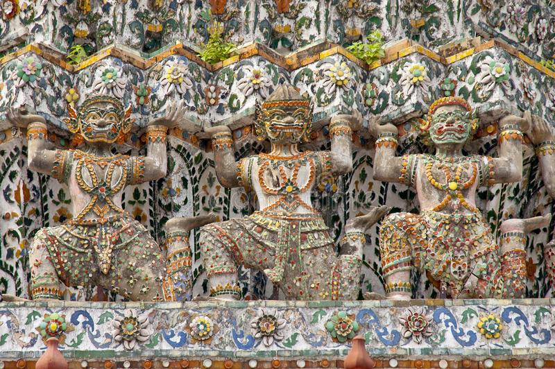 Warriors statues at the temple Wat Arun in Bangkok, Thailand.  royalty free stock photography