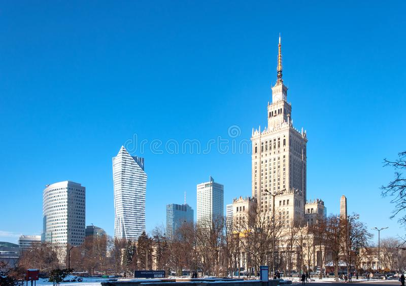 Warsaw city center in winter. Warsaw city center with Palace of Culture and Science PKiN, a landmark and symbol of Stalinism and communism, and modern sky royalty free stock photography