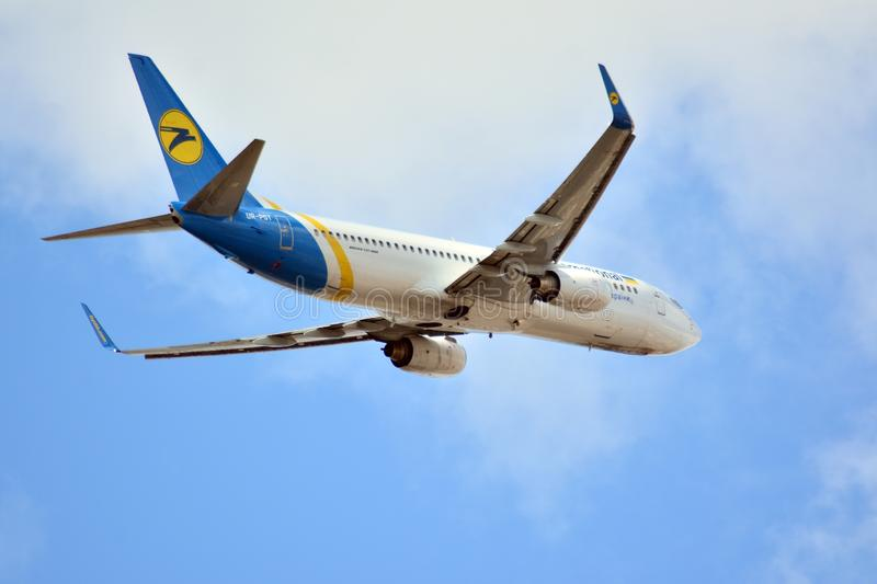 Airplane UR-PST Ukraine International Airlines Boeing 737-8AS  taking off from the Warsaw Chopin Airport. stock images